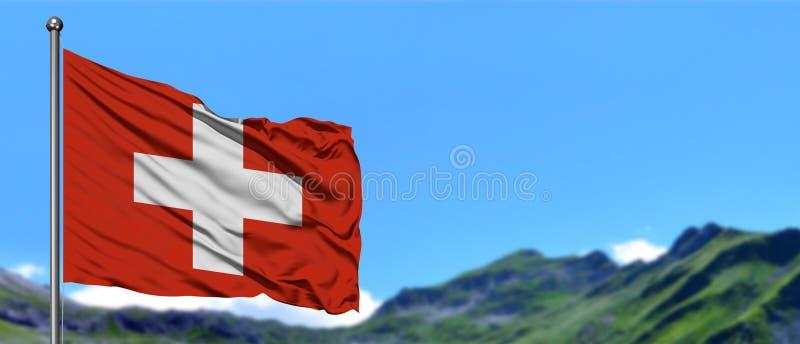 Bandeira de Suíça que acena no céu azul com campos verdes no fundo do pico de montanha Tema da natureza fotografia de stock