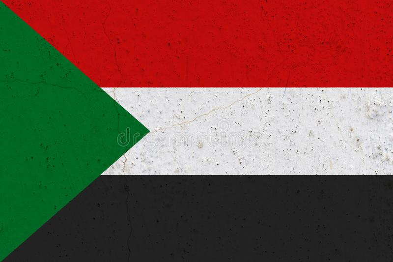 Bandeira de Sudão no muro de cimento fotografia de stock