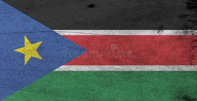 Bandeira de Sudão sul no fundo de madeira da placa Textura sul da bandeira de Sudão do Grunge imagens de stock royalty free