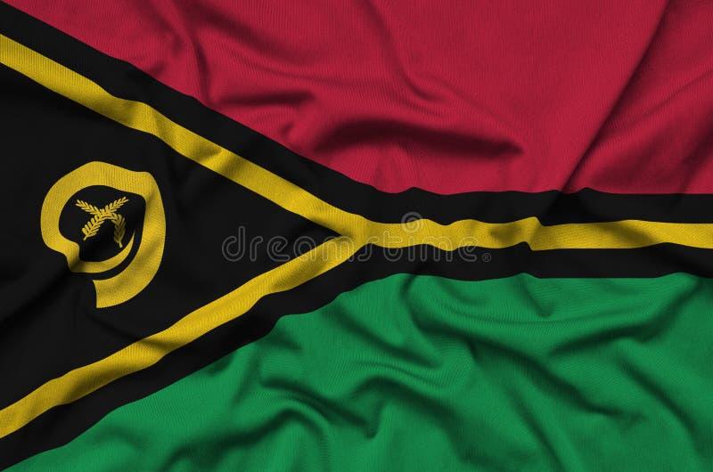 A bandeira de Vanuatu é descrita em uma tela de pano dos esportes com muitas dobras Bandeira da equipe de esporte fotografia de stock
