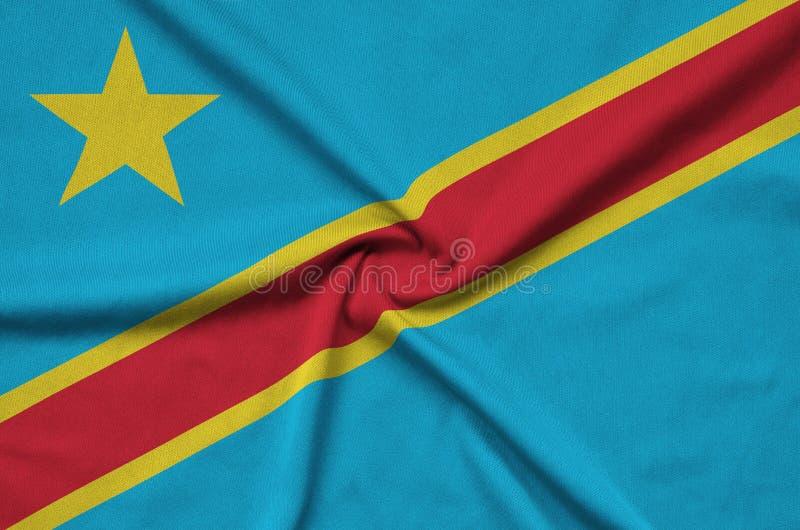 A bandeira Democrática da República Democrática do Congo é descrita em uma tela de pano dos esportes com muitas dobras Bandeira d imagem de stock royalty free