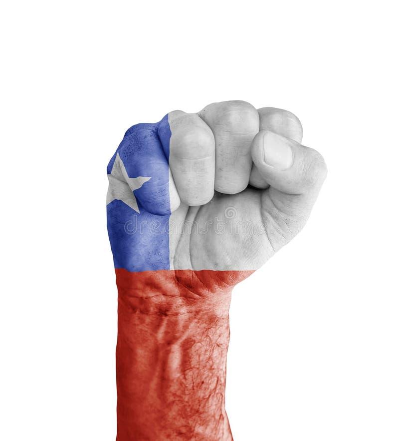 A bandeira do Chile pintou no punho humano como o símbolo da vitória fotos de stock