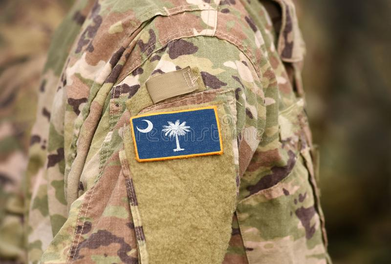 Bandeira do Estado da Carolina do Sul sobre uniforme militar Estados Unidos EUA, exército, soldados Colagem fotos de stock royalty free