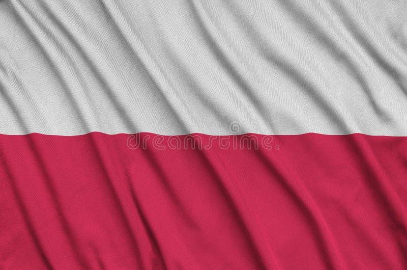 A bandeira do Polônia é descrita em uma tela de pano dos esportes com muitas dobras Bandeira da equipe de esporte imagem de stock royalty free
