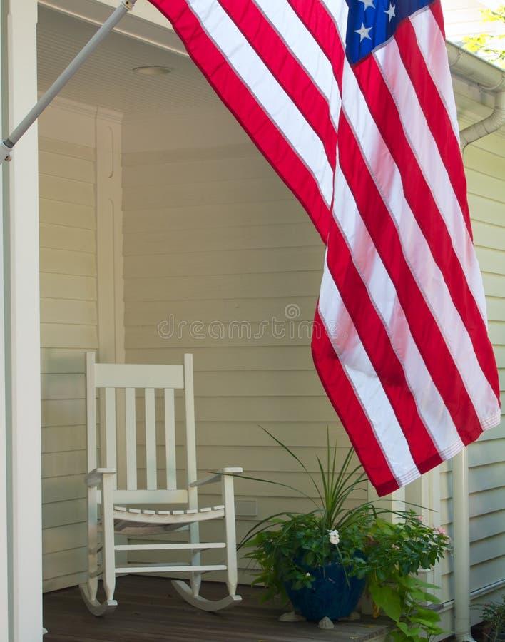 Bandeira e cadeira de balanço fotografia de stock