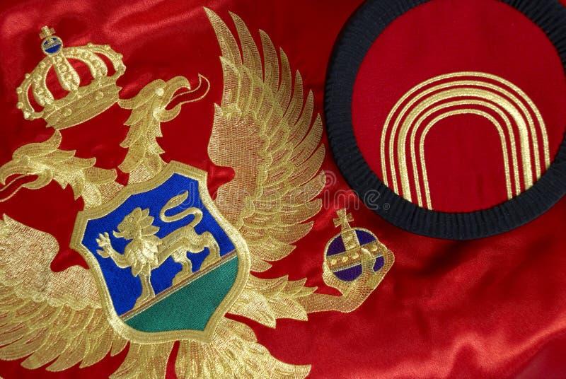 Bandeira e tampão montenegrinos fotos de stock royalty free
