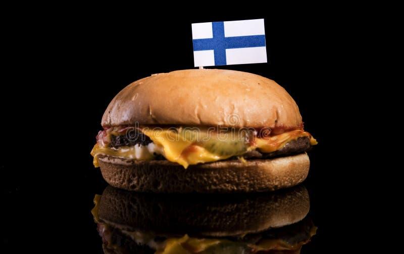 Bandeira finlandesa sobre o Hamburger isolado no preto imagem de stock royalty free