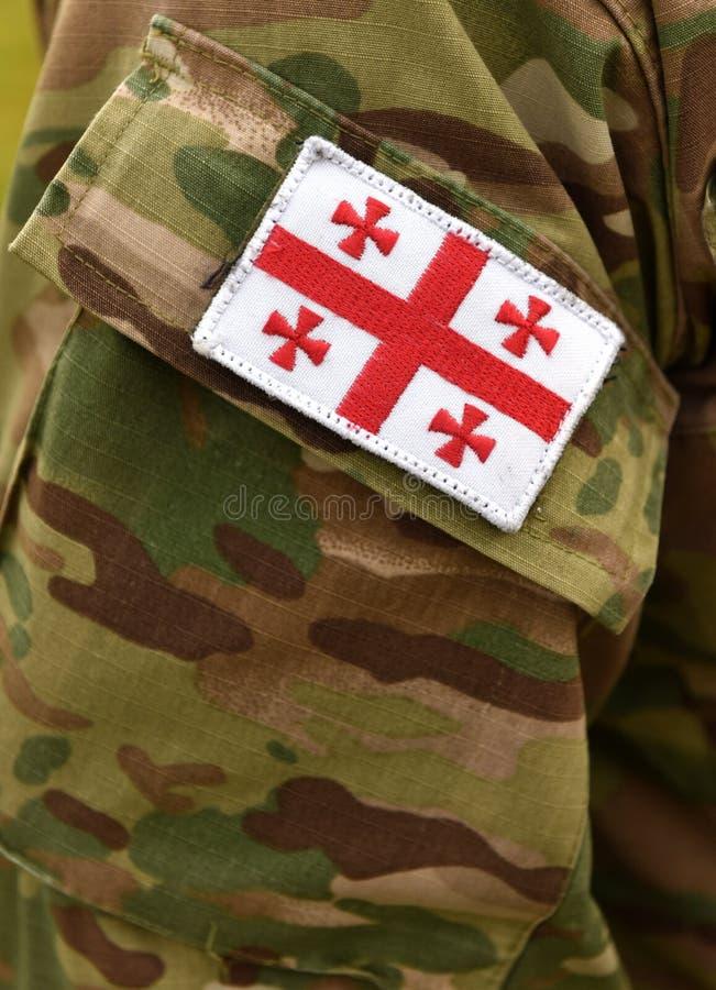 Bandeira Georgian do remendo no braço dos soldados Tropas de Geórgia fotos de stock royalty free