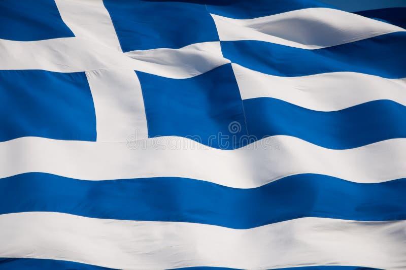 Bandeira grega na acrópole de Atenas, Grécia. imagem de stock royalty free