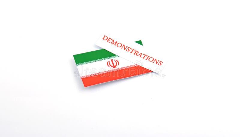 A bandeira iraniana com demonstrações da palavra nela isolou-se nos vagabundos brancos foto de stock royalty free