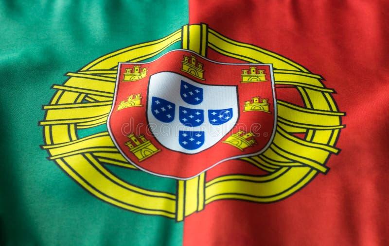 Bandeira portuguesa que acena de uma vista dianteira imagens de stock royalty free