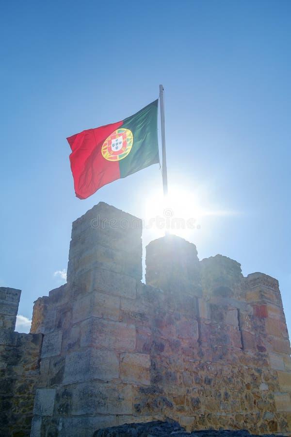 Bandeira portuguesa que flui acima fotografia de stock royalty free