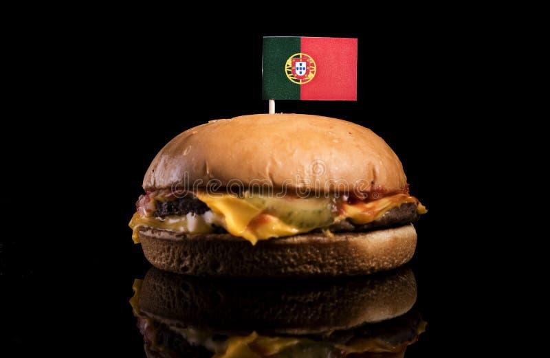Bandeira portuguesa sobre o Hamburger no preto fotos de stock royalty free