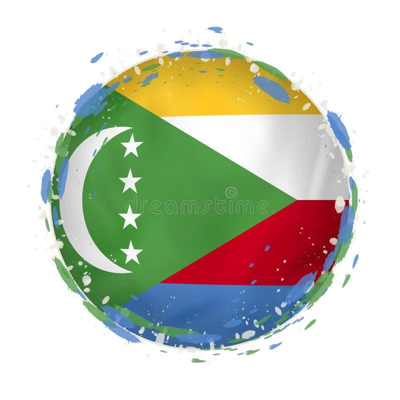 A bandeira redonda do grunge de Comores com espirra na cor da bandeira ilustração stock