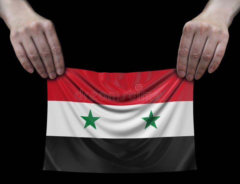 Bandeira síria nas mãos foto de stock