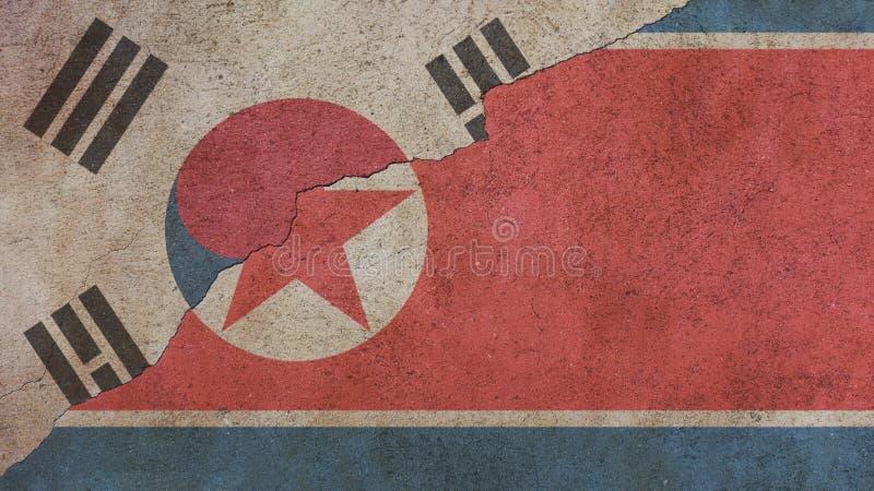 Bandeiras da Coreia do Norte e de Coreia do Sul no concreto fotografia de stock royalty free