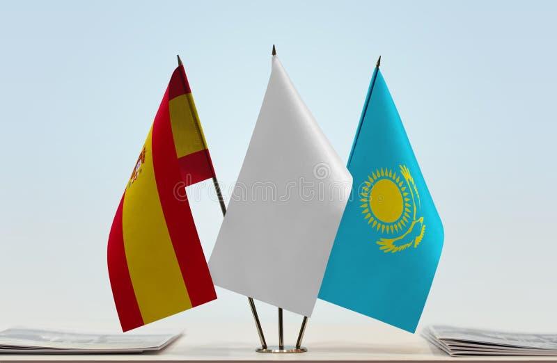 Bandeiras da Espanha e do Cazaquistão fotografia de stock royalty free