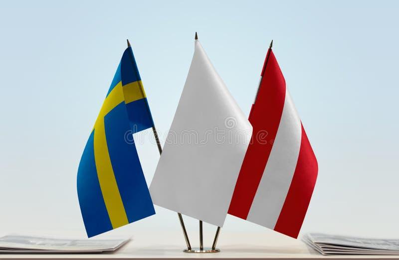 Bandeiras da Suécia e da Áustria fotos de stock