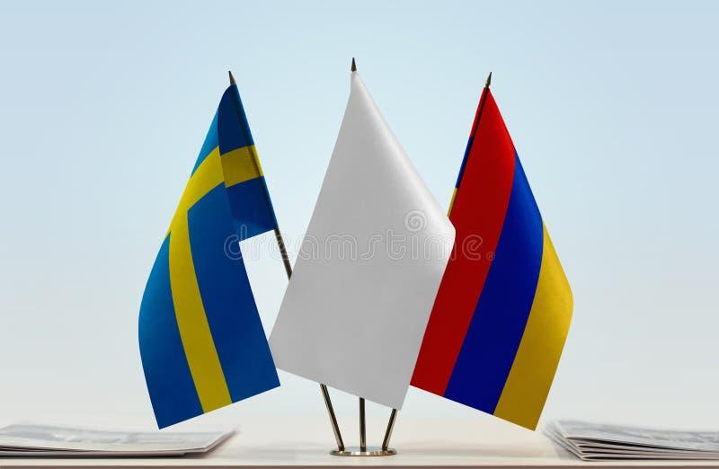 Bandeiras da Suécia e da Armênia imagem de stock royalty free