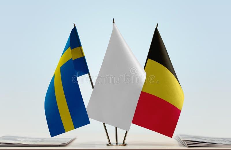 Bandeiras da Suécia e da Bélgica imagem de stock royalty free