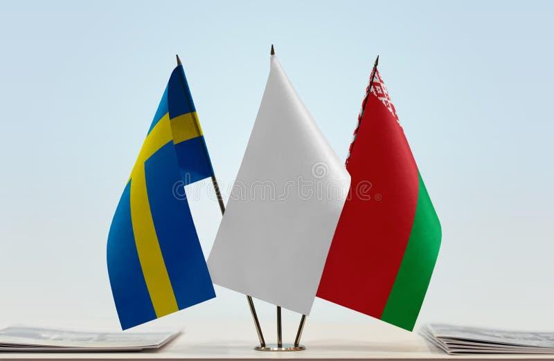 Bandeiras da Suécia e do Bielorrússia fotos de stock royalty free