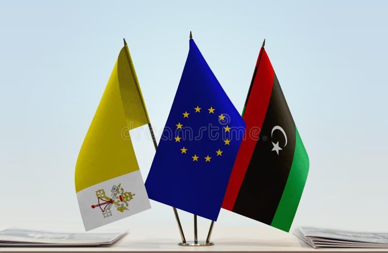 Bandeiras da UE de Cidade Estado do Vaticano e da Líbia imagens de stock
