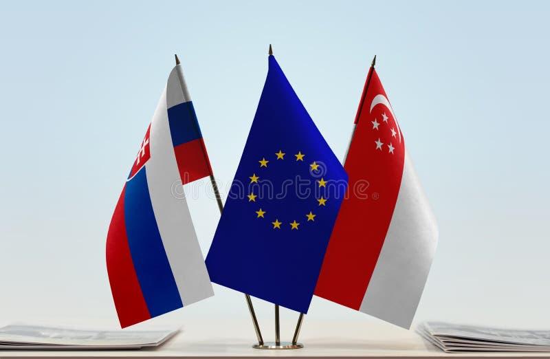 Bandeiras da UE de Eslováquia e do Singapura fotos de stock royalty free