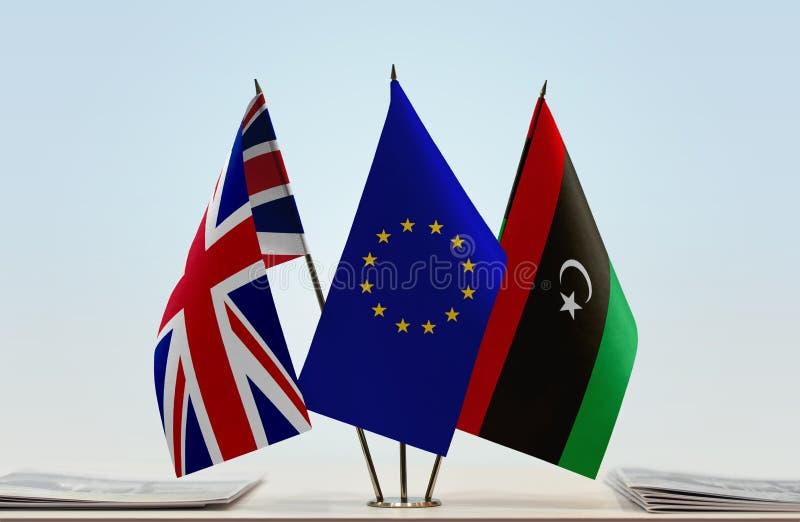 Bandeiras da UE de Grâ Bretanha e da Líbia imagem de stock
