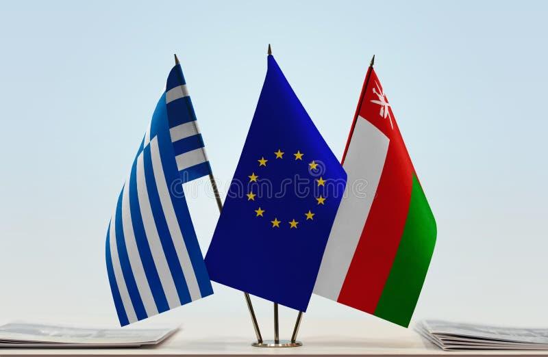 Bandeiras da UE de Grécia e do Omã imagens de stock royalty free