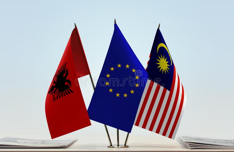 Bandeiras da União Europeia e do Malásia de Albânia imagem de stock royalty free
