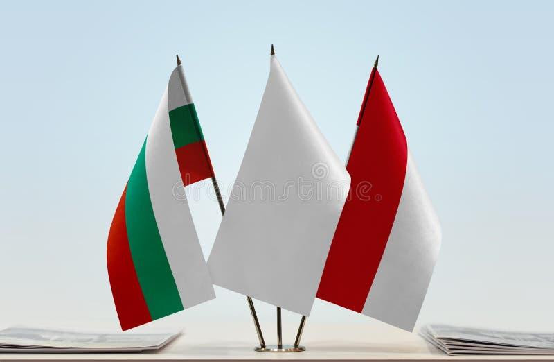 Bandeiras de Bulgária e de Mônaco fotografia de stock