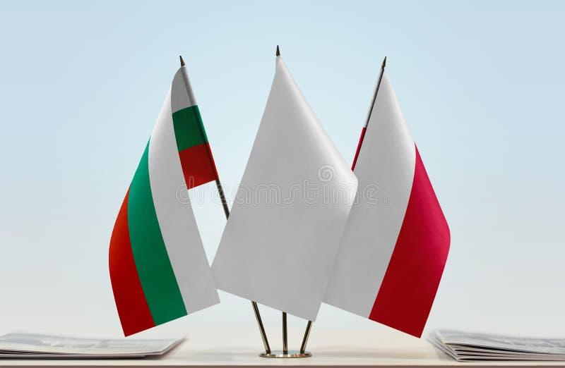 Bandeiras de Bulgária e de Polônia fotos de stock royalty free