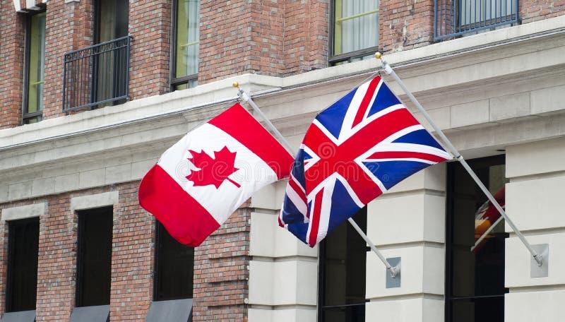 Bandeiras de Canadá Grâ Bretanha fotografia de stock royalty free