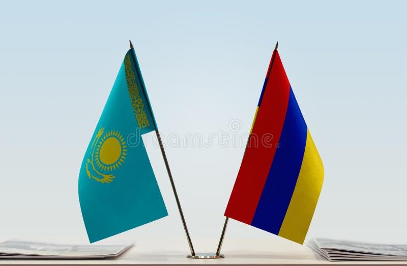 Bandeiras de Cazaquistão e de Armênia fotografia de stock