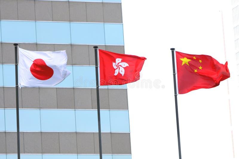 Bandeiras de China, de Hong Kong e de Japão fotografia de stock