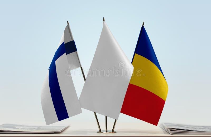 Bandeiras de Finlandia e de Romênia foto de stock royalty free