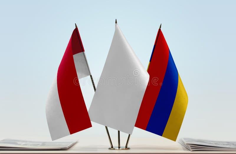 Bandeiras de Mônaco e de Armênia foto de stock royalty free