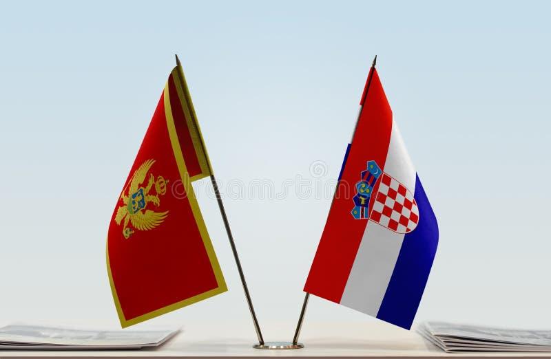 Bandeiras de Montenegro e da Croácia imagem de stock
