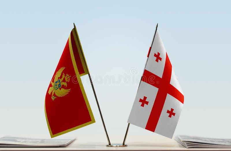 Bandeiras de Montenegro e de Geórgia imagem de stock
