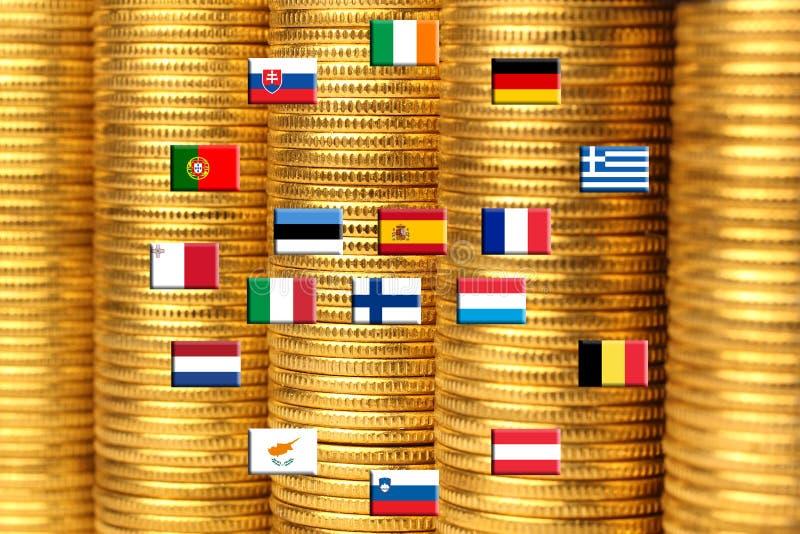 Bandeiras de países do eurozone de encontro às pilhas das moedas fotos de stock royalty free