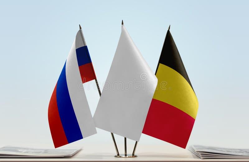 Bandeiras de Rússia e de Bélgica imagens de stock royalty free