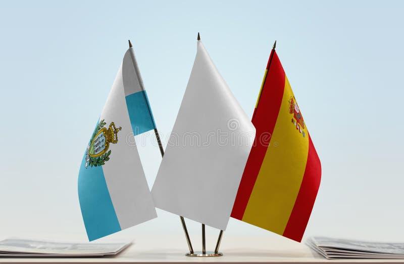 Bandeiras de São Marino e da Espanha fotos de stock