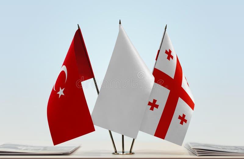 Bandeiras de Turquia e de Geórgia fotos de stock royalty free