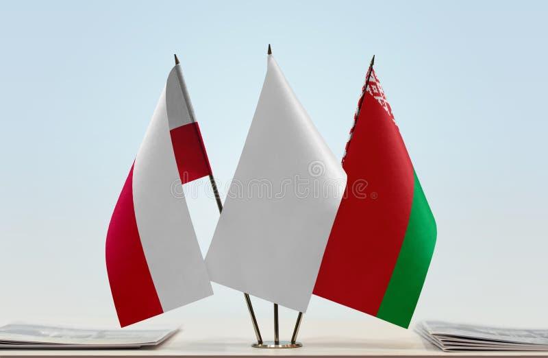 Bandeiras do Polônia e do Bielorrússia fotografia de stock royalty free