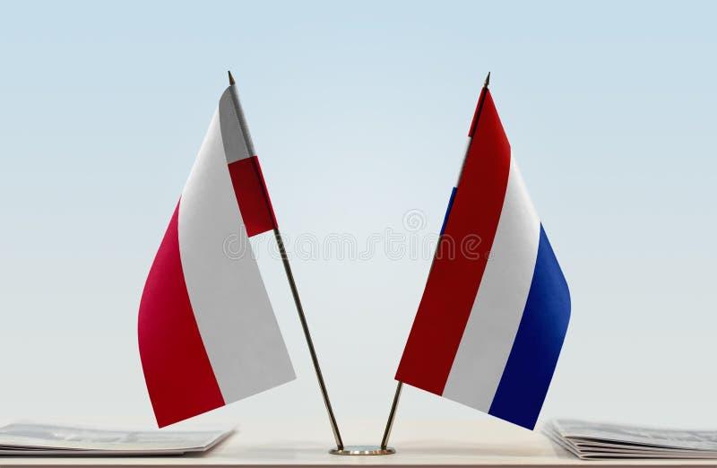 Bandeiras do Polônia e dos Países Baixos imagens de stock