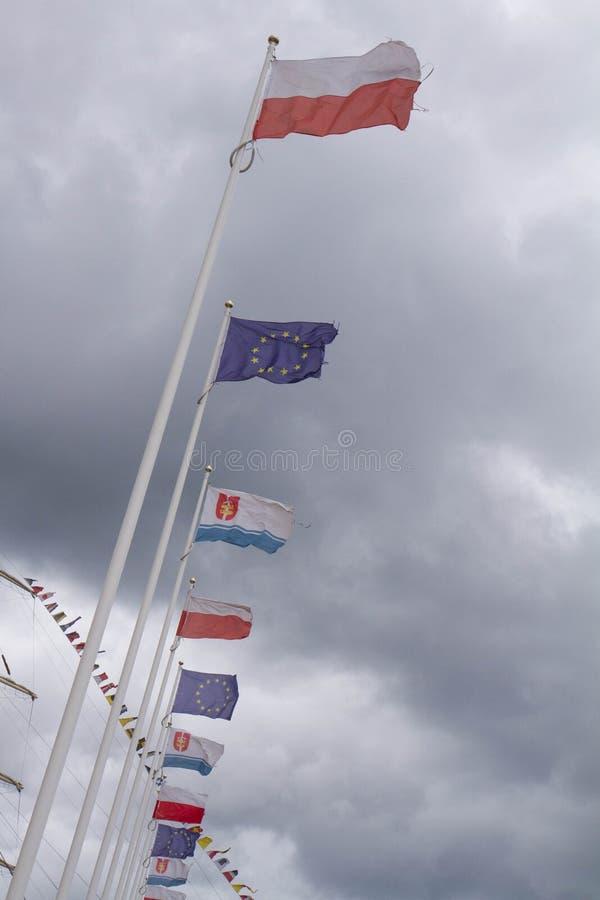 Bandeiras e um mastro fotografia de stock