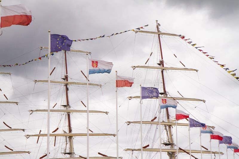 Bandeiras e um mastro fotografia de stock royalty free