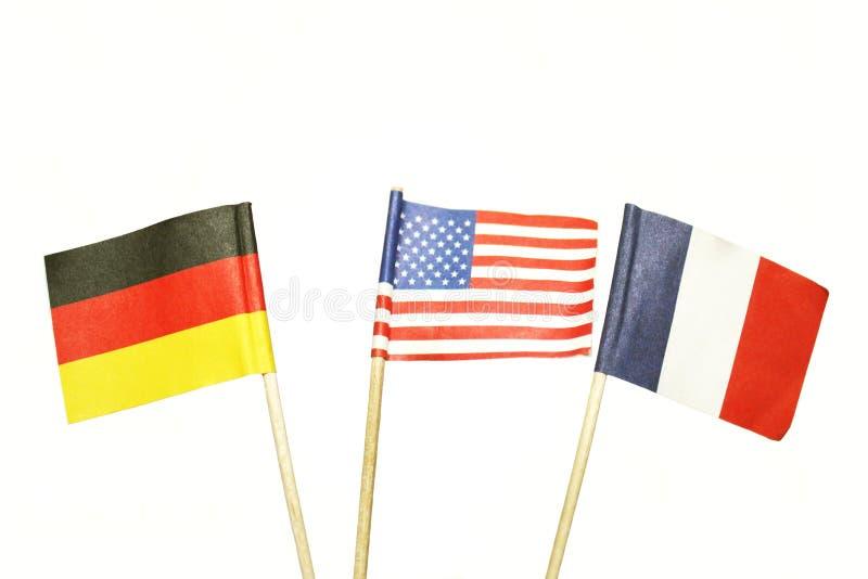 Bandeiras francês-alemão americanas fotografia de stock