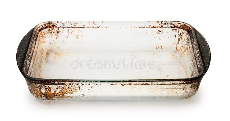 Bandeja de cristal sucia vacía vieja de la hornada imágenes de archivo libres de regalías