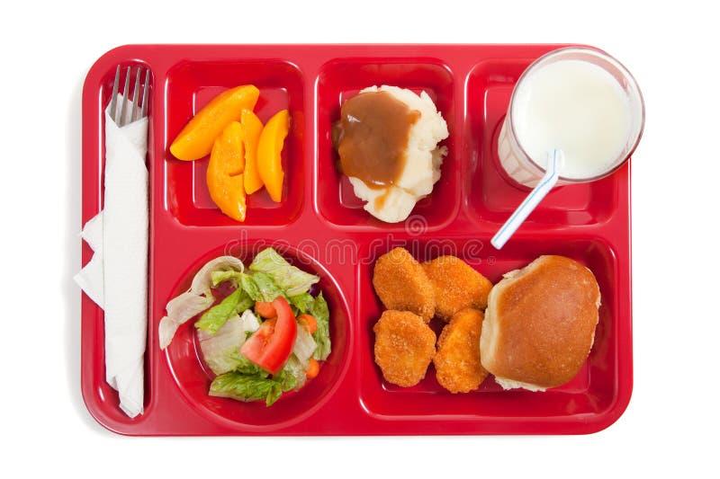 Bandeja do almoço de escola em um fundo branco fotografia de stock royalty free